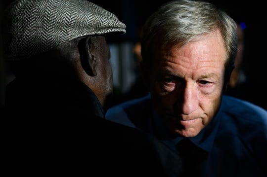 Democratic presidential candidate Tom Steyer meets with voters during a campaign event at a Kickin' Chicken in SummervilleThursday, Feb. 27, 2020.