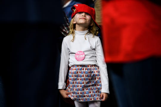 Joy Collins, 6, of Ravenel, waits for a rally for President Donald Trump to begin at the North Charleston Coliseum Friday, Feb. 28, 2020.