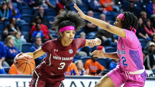 South Carolina guard Destanni Henderson (3) drives toward the basket while defended by Florida guard Ariel Johnson (32) during the first half of an NCAA college basketball game Thursday, Feb. 27, 2020, in Gainesville, Fla. (AP Photo/Gary McCullough)