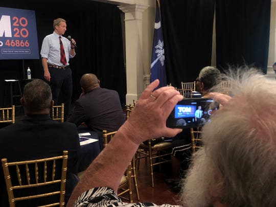 Democratic presidential candidate Tom Steyer speaks to a crowd of 50 at the O'Donnell House in Sumter, SC on Friday, Feb .28, 2020, one day before the primary election.