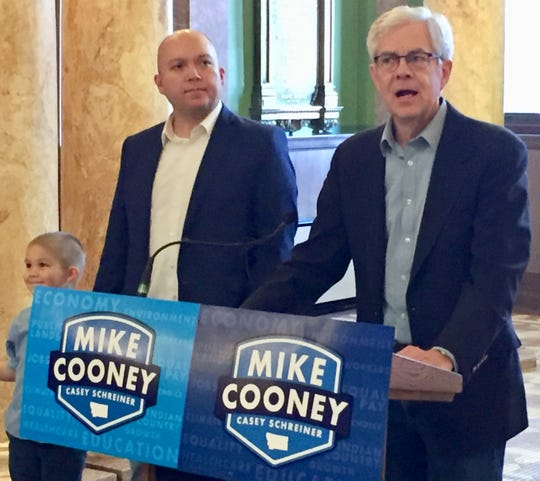 Democratic gubernatorial candidate Mike Cooney, right, announces Casey Schreiner as his pick for lieutenant governor Friday. Af far left is Schreiner's son, Liam.