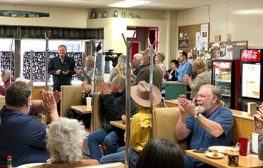 U.S. Sen. Steve Daines, a Republican, files to run Friday for another six-year term via cellphone during a stop in Conrad.