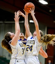 Augusta's Payton Levine secures a rebound over teammate CarolAnn Herring and Hays-Lodgepole's Judemia Gray during the Northern C Divisional Basketball Tournament in the Four Seasons Arena on Thursday.