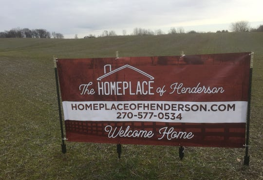 A sign in the filed off Green River Road near the intersection of Osage Drive announces The Homeplace of Henderson senior living development.