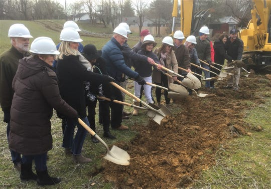 During a ceremony Friday morning, investors in The Homeplace of Henderson senior living development take their turn at officially turning dirt on the project.