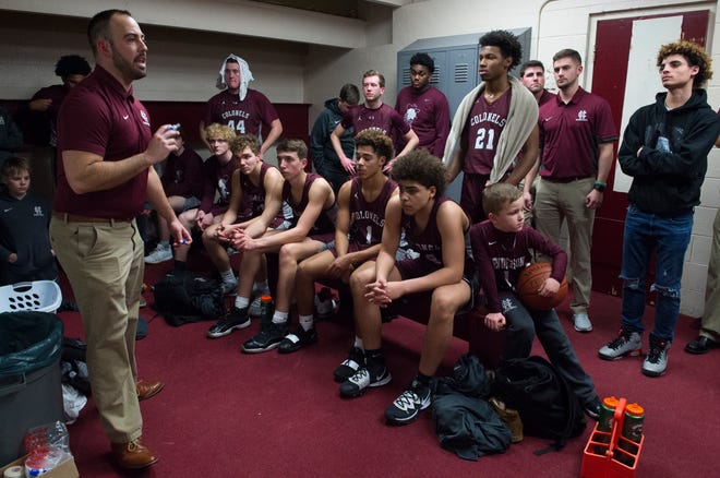 Henderson County Head Coach Tyler Smithhart gives direction in the locker room during halftime as the Henderson County Colonels play the Webster County Trojans during the Sixth District championship basketball game at Webster County High School in Dixon, Ky., Thursday evening, Feb. 27, 2020.