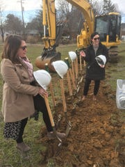 Jessica Beaven, co-creator of The Homeplace of Henderson along with her husband Patrick, sets up ceremonial shovels and hard hats with local economic development staffer Whitney Risley Friday before a groundbreaking ceremony.