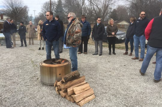 With temperatures in the upper 30s Friday morning, wood-burning heaters were a nice touch at Friday morning's groundbreaking for The Homeplace of Henderson.