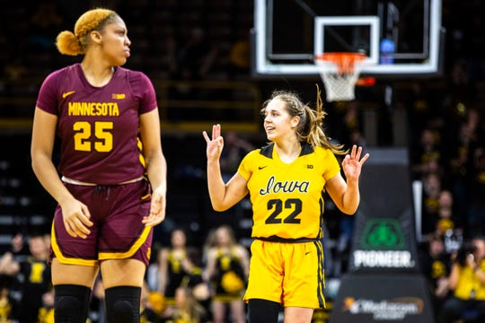 Iowa guard Kathleen Doyle (22) celebrates after making a 3-point basket as Minnesota's Klarke Sconiers (25) reacts during a NCAA Big Ten Conference women's basketball game, Thursday, Feb. 27, 2020, at Carver-Hawkeye Arena in Iowa City, Iowa.