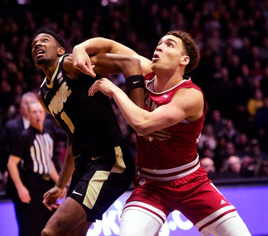 Purdue Boilermakers forward Aaron Wheeler (1) and  Indiana Hoosiers forward Race Thompson  (25) fight for position in the first half at Mackey Arena.