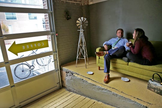 Greg Freeman, left, and Alexis Snyder sneak away for coffee and a chat at quiet Kaffeine Coffee Co., hidden just off Mass Ave. in a string of old buildings at 707 Fulton St., downtown Indianapolis.