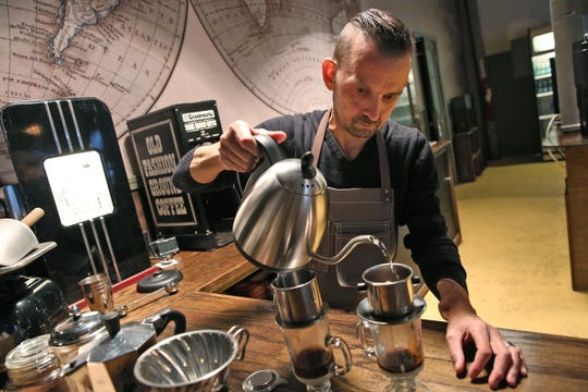 Chis Kilander makes coffee with Vietnamese beans at Kaffeine Coffee Co., hidden just off Mass Ave. in a string of old buildings at 707 Fulton St., downtown Indianapolis. Kilander owns the coffee shop with his wife Amanda Kilander.