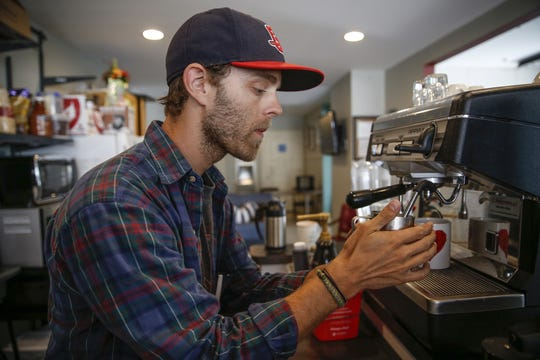 Jon Crawford steams milk at Lincoln Lane Coffee Co., tucked The Lincoln Center in the Bates-Hendricks neighborhood of Indianapolis.