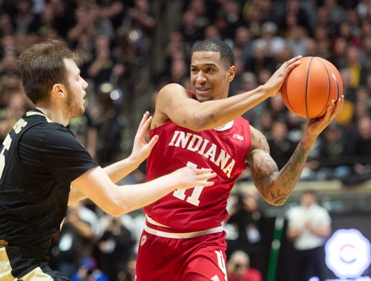 Indiana Hoosiers guard Devonte Green (11) is guarded by Purdue Boilermakers guard Sasha Stefanovic (55) in the first half at Mackey Arena.