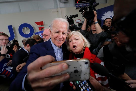 Democratic presidential candidate Joe Biden takes photos with supporters after speaking at a campaign event in Sumter, S.C., on Friday.