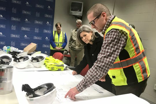 Jon Olson, the new plant director, shows U.S. Joni Ernst the drawings for Goodwill of the Heartland's completed vegetable oil packaging plant in Coralville on Friday, Feb. 28.