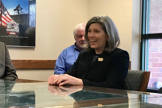 U.S. Sen. Joni Ernst talks with Coralville City Councilors about an interchange project in Coralville on Friday, Feb. 28.