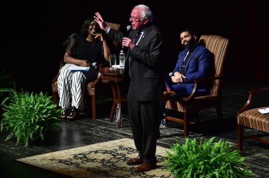 Jackson Mayor Chokwe Antar Lumumba, right, listens as U.S. Sen. Bernie Sanders, center, of Vermont answers a question during a town hall meeting Wednesday in Jackson, Miss. examining economic justice 50 years after the assassination of Dr. Martin Luther King Jr. Wednesday, April 4, 2018.