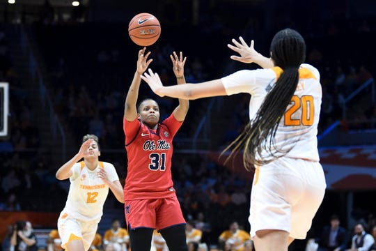 Ole Miss guard Deja Cage (31) attempts to score while guarded by Tennessee center Tamari Key (20) in the NCAA women's basketball game at Thompson-Boling Arena on Thursday, February 27, 2020.