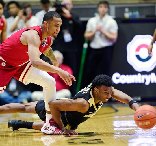 Feb 27, 2020; West Lafayette, Indiana, USA;   Purdue Boilermakers forward Aaron Wheeler (1) and Indiana Hoosiers guard Devonte Green (11) fight for a loose ball  at Mackey Arena. Mandatory Credit: Thomas J. Russo-USA TODAY Sports