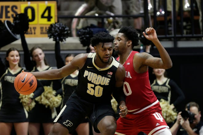 Purdue forward Trevion Williams (50) dribbles against Indiana guard Rob Phinisee (10) during the first half of a NCAA men's basketball game, Thursday, Feb. 27, 2020 at Mackey Arena in West Lafayette.