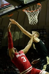 Purdue center Matt Haarms (32) blocks Indiana forward Justin Smith (3)'s layup during the first half of a NCAA men's basketball game, Thursday, Feb. 27, 2020 at Mackey Arena in West Lafayette.