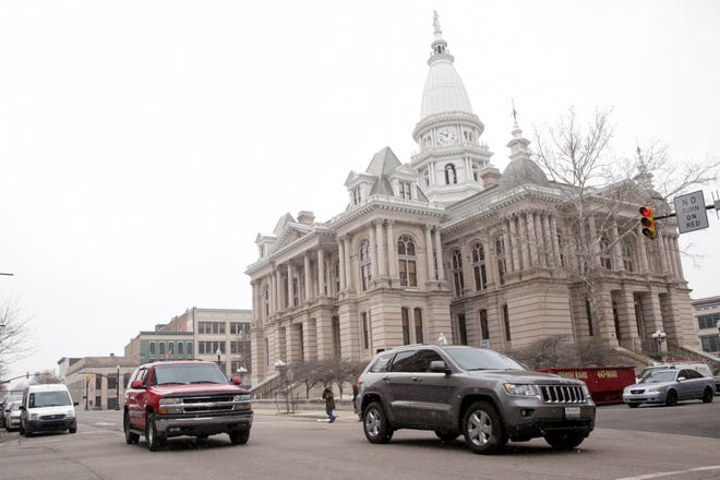 Traffic flows northbound on Fourth Street past the Tippecanoe County Courthouse, Friday, Feb. 28, 2020 in Lafayette.