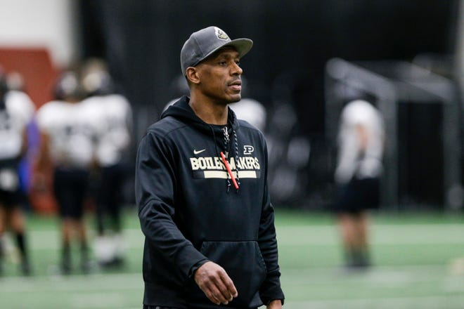 Purdue assistant coach Anthony Poindexter walks across the field during a football practice, Friday, Feb. 28, 2020 in West Lafayette.
