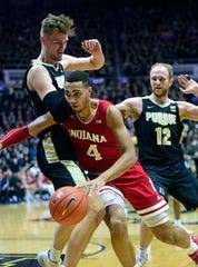 Feb 27, 2020; West Lafayette, Indiana, USA;  Indiana Hoosiers forward Trayce Jackson-Davis (4) drives into  Purdue Boilermakers center Matt Haarms (32)  in the first half at Mackey Arena. Mandatory Credit: Thomas J. Russo-USA TODAY Sports