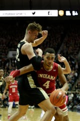 Indiana forward Trayce Jackson-Davis (4) dribbles against Purdue center Matt Haarms (32) during the first half of a NCAA men's basketball game, Thursday, Feb. 27, 2020 at Mackey Arena in West Lafayette.