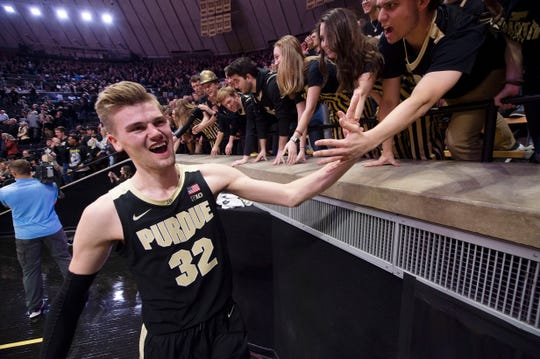 Feb 27, 2020; West Lafayette, Indiana, USA;  A Purdue Boilermaker center Matt Haarms (32) celebrates with  Boilermaker fans after their game against the Indiana Hoosiers  at Mackey Arena. Mandatory Credit: Thomas J. Russo-USA TODAY Sports