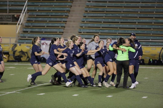 The St. Thomas More girls soccer team celebrates after winning the LHSAA Division II girls soccer championship over Ben Franklin High Thursday, Feb. 27, 2020.