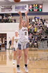 Hartland's Amanda Roach shoots the go-ahead free throw with 2.2 seconds left in a 32-30 victory over Brighton in the KLAA girls basketball championship game on Thursday, Feb. 27, 2020.