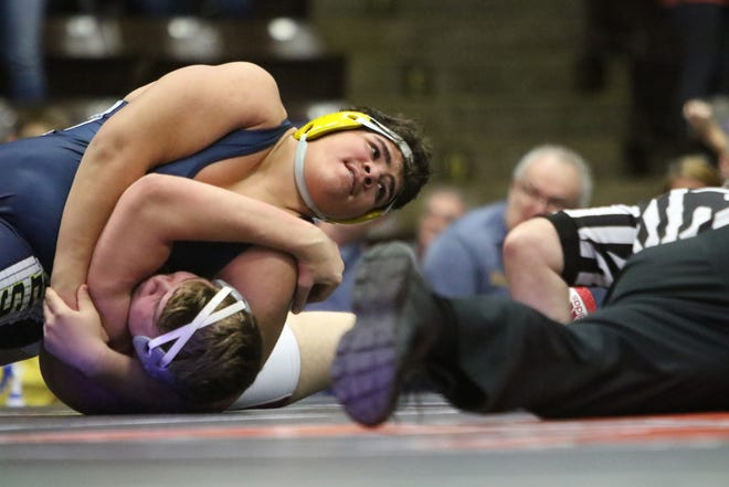 Hartland Eagle 285-pounder Cameron Shirley wrestles Temperance Bedford's Cole Bettencourt in quarterfinals Friday, Feb. 28, 2020.