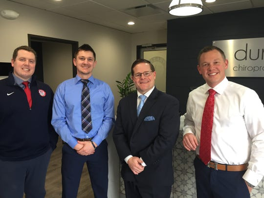 Duncan Chiropractic Group opened a new chiropractic and massage therapy clinic inside Cleary University's athletics and wellness facility. From left, co-owner Mike Hilton, clinic head Adam Leibinger, Cleary University official Matt Bennett, and co-owner Kevin Michalak stand in the lobby, Friday, Feb. 28, 2020.