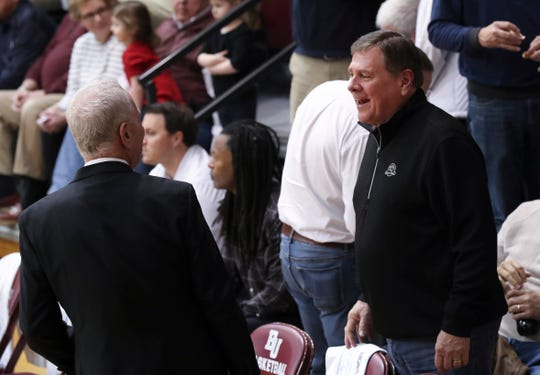 Former Louisville athletic director Tom Jurich, right, chatted with Bellarmine head coach Scott Davenport during halftime of their game against Southern Indiana at Knights Hall in Louisville, Ky. on Feb. 27, 2020.