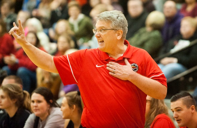 Bullitt East head basketball coach Chris Stallings calls a defense in the KHSAA 24th District Girls Basketball Tournament championship game.Feb. 27,  2020