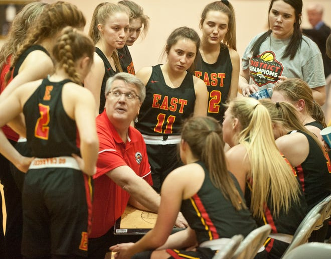 Bullitt East head basketball coach Chris Stallings talks to his players during a time-out in the KHSAA 24th District Girls Basketball Tournament championship game.