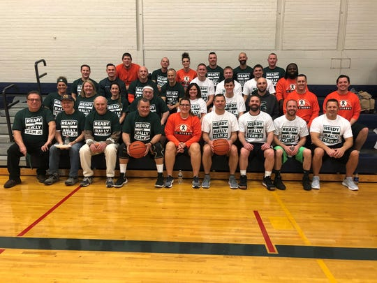 Staff, friends, family and community members competed in a basketball game at Tuesday's rally to help raise money and show support for the Cole family.