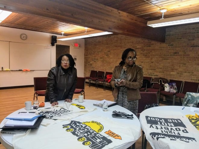 LaShawn Erby (left) runs a Metro Lansing Poor People's Campaign meeting at Edgewood United Church on Feb. 20, 2020. Erby wrote the play Turn it Around, which will be performed in Lansing and around the state.