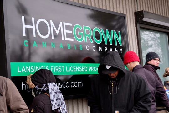 People wait outside HomeGrown as the provisioning center opens on Friday, Feb. 28, 2020