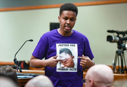 Farhan Sheikh-Omar of Lansing addresses members of the East Lansing Police Department during a special city council meeting involving his friend Uwimana Gasito, who accused the department of using excessive force in an incident earlier this month.