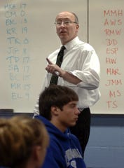 Lansing Catholic High School Doug Moore teaches a class in this LSJ file photo from 2005