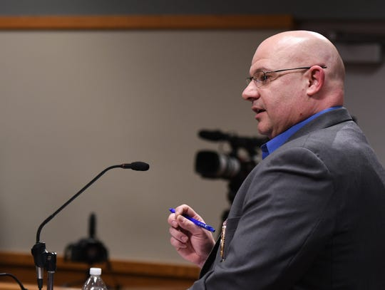 Capt. Chad Connelly of the East Lansing Police Department addresses city council Thursday, Feb. 27, 2020, during a special meeting regarding an investigation into allegations against police made earlier in the month.