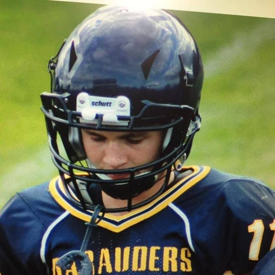 Justin Cole, now 15, of Ovid-Elsie schools is pictured in a football uniform from his youth football playing days.