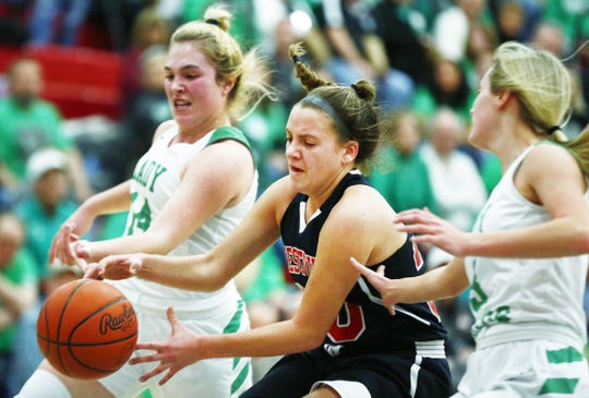 Crestview High School's Mary Leeper (20) struggles to hang onto the ball as Margaretta High School's Jayden Moore (14) and Elliana Schaefer (3) apply pressure in the 2020 Northwest Division III Girls Basketball Sectional/District at Shelby High School Thursday, February 27, 2020.