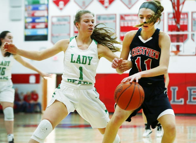 Crestview High School's Kathleen Leeper (11) drives the ball as Margaretta High School's Jaelie Keller (1) guards in the 2020 Northwest Division III Girls Basketball Sectional/District at Shelby High School Thursday, February 27, 2020.