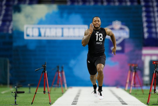 Memphis wide receiver Antonio Gibson runs the 40-yard dash at the NFL football scouting combine in Indianapolis, Thursday, Feb. 27, 2020. (AP Photo/Charlie Neibergall)