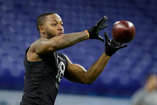 Memphis wide receiver Antonio Gibson runs a drill at the NFL football scouting combine in Indianapolis, Thursday, Feb. 27, 2020. (AP Photo/Michael Conroy)