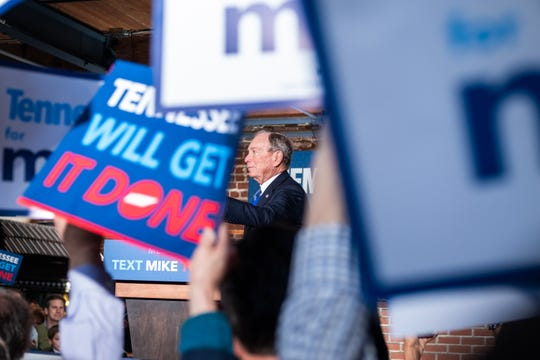 Mike Bloomberg arrives at his Memphis rally at Minglewood Hall as supporters cheer and wave signs, Friday, Feb. 28, 2020, in Memphis, Tenn.